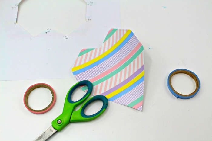 Add washi tape to your heart for your DIY Valentine's Day craft.