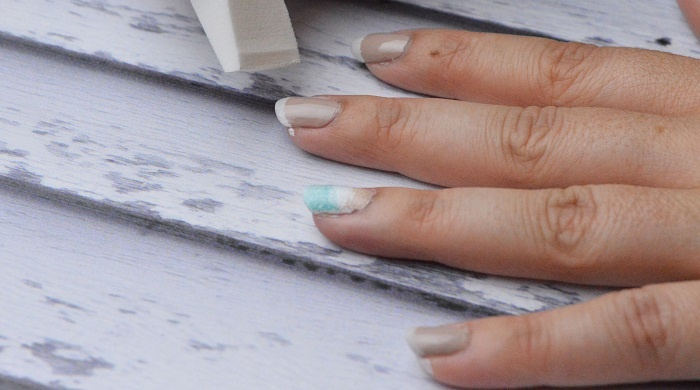 Beach Waves Nail Art Design: Add white polish to the tips of your nails.