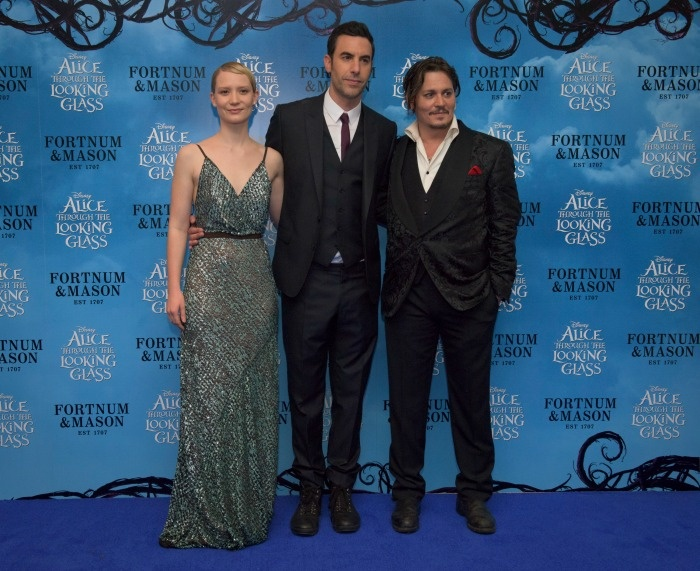 Mia Wasikowska (Alice Kindleigh), Sacha Baron Cohen (Time) and Johnny Depp (The Mad Hatter) At The Alice In Wonderland Through The Looking Glass movie premiere in London