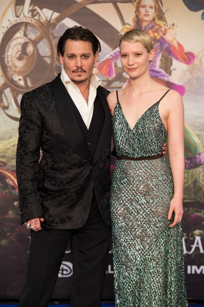 The UK Movie Premiere of Alice In Wonderland Through The Looking Glass Johnny Depp (The Mad Hatter) & Mia Wasikowska (Alice Kindleigh)