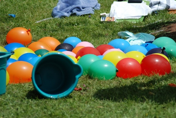 Water Balloon fights are fun outside party games for kids!
