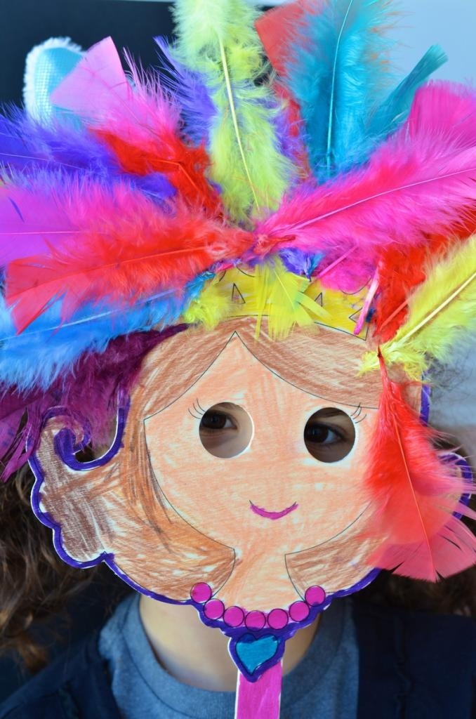 Let kids unleash their creativity and show off their imaginations with this fun & vibrant doll puppet craft for kids featuring colorful feathers.